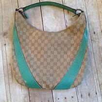 100% Authentic Gucci Monogrammed Canvas Print W/ Turquoise Leather Handbag Photo