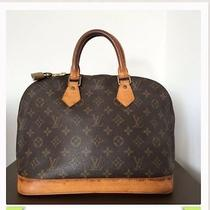 100% Authentic Louis Vuitton Alma. Pre-Owen Bag. Used Bag. Photo