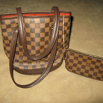 100 % Authentic Louis Vuitton Brighton Coach Purses Photo