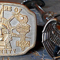 2 Vintage Buckles 1986 Statue of Liberty Cent. & Avon American Eagle Ships Free Photo