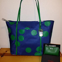 340 Womens Tumi Voyageur Q-Tote Juan Obando  Prism Leather Wallet Blue Green Photo