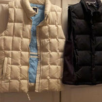 A Lot of 2 Gap Puffer Vests Size Large Black  and Cream Photo