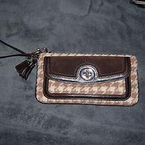 A New Coach Wristlet and a Mint Excellent Condition Fossil Wallet  Photo