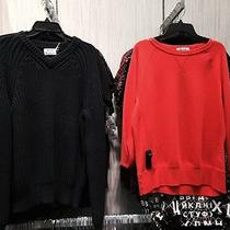 Acne Jackets and Sweaters Sold Sep.  Prices Vary Photo