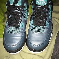 Air Jordan 4s Teal Photo