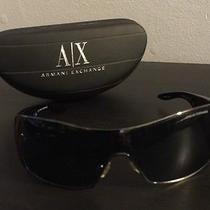 Armani Exchange Unisex Black and Chrome Sunglasses (Wrap Style Lens) Photo