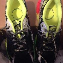 Asics Gel-Noosa Tri 9 Gs Running Shoe Youth 4-1/2 Black/red/flashy Yellow Photo