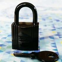 Auth Hermes So Black Kelly Birkin Lock Lacquered Steel Padlock & Key Pre Loved Photo