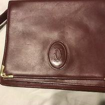 Authentic Cartier Mastline Unisex Clutch With Strap.  Burgundy and Gold Photo