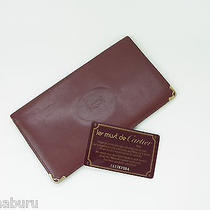 Authentic Cartier Paris Wine Red Leather Long Wallet Bifold Purse Photo