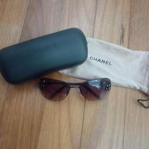 Authentic Chanel Sunglasses With Acrylic Camelia Embellishment Photo