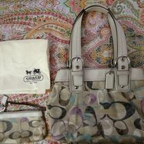 Authentic Coach Handbag and Wristlets   Photo