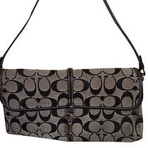 Authentic Coach Handbag Black and White Signature Cloth. Perfect for a Night Out Photo