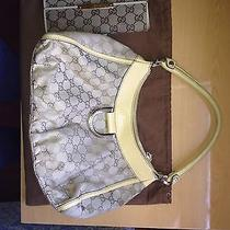 Authentic Gucci Handbag and Wallet Photo
