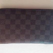 Authentic Louis Vuitton Damier Graphite Zippy Long Wallet/organazer. Photo