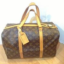 Authentic Louis Vuitton Sac Souple 35 With Lock and Key Photo