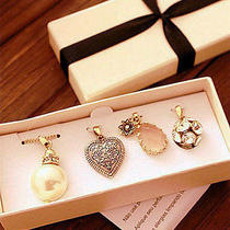 Avon 4 Pendant & 1 Chain Set Brand New in Original Box Photo