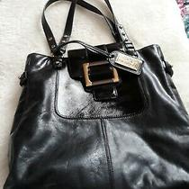 Badgkey Mischka Black Leather Purse With Gold Details Photo