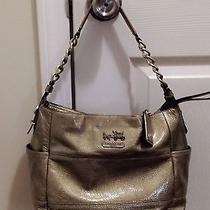 Beautiful Gold Coach Purse Photo
