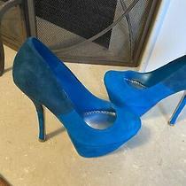 Bebe High Heels and Black Booties Photo