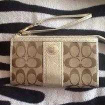 Beige and Gold Coach Wristlett  Photo