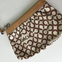 Beige and Tan Coach Wristlet Photo