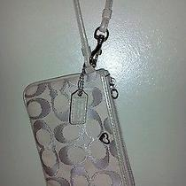 Beige Coach Wristlet   Photo