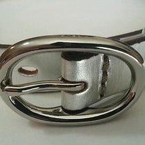 Beltskinnyleathersilverperforatedsilvertone Buckle & Pinsze.
