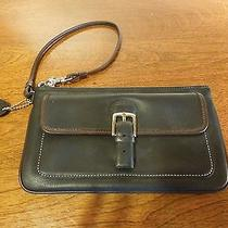Black and Brown Leather Coach Clutch With Buckle and Wrist Strap Photo
