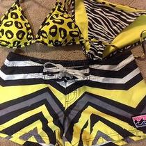 Black and Yellow Bikini and Billabong Shorts Photo