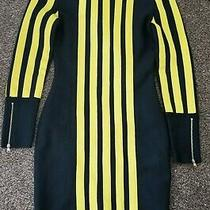 Black and Yellow Bodycon Bandage Dress. Preowned and in Excellent Condition. Photo