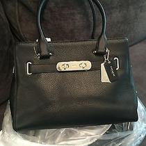 Black Coach Handbag With 2 Straps and Gold Hardware Photo