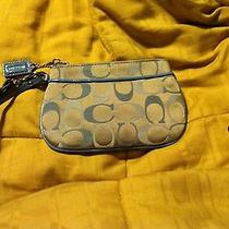 Blue and Tan Coach Wristlet Photo