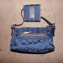 Blue Coach Purse and Wallet Photo