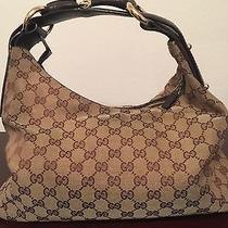 Brown Gucci Logo Handbag With Large Gold Horsebit Gg Hobo Photo