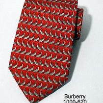 Burberrys Smooth Silk Neck Tie Repeating Dolphin Print Hand Sewn Red Photo