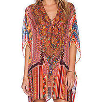 Camilla in the Name of the Tribe Short Lace Up Caftan Photo