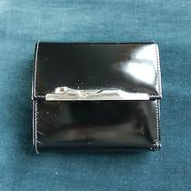 Cartier Black Leather Men's Wallet With Metal Art Deco Jaguar Trim Photo