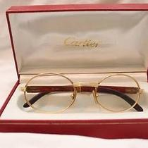 Cartier Glasses Gold/wood Photo