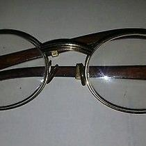 Cartier Gold Round Eyeglasses Wood Photo