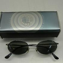 Celebrating the Millennium Fossil 2000 Sunglasses in Collector's Tin Photo