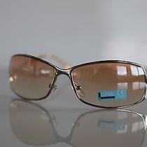 Chrome Frame  Golden Golden Brown Lenses by Diva Level One Photo