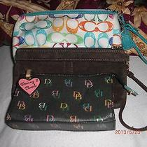 Coach and Dooney and Bourke Wristlets and Money Purse. 4 Total.  Photo