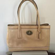 Coach Beige  Handbag. Very Good Condition. One Small Imperfection. Photo
