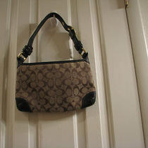 Coach Brown Signature C Bleeker Hobo Bag 11430. Photo