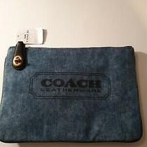 Coach Denim Clutch Lightweight Sporty and Stylish Holds Your Essentials.  Photo