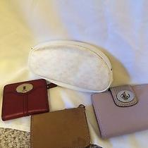 Coach  Fossil Wallets and Gucci  Cosmetic Pouch Photo