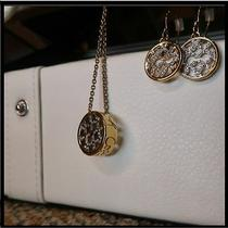 Coach Op Art Pave Crystal Disc Necklace and Matching Earring Set Gold Photo