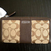 Coach Parker Signature Accordion Zip Wallet F49159 Color- Khaki/ Mahogany Photo