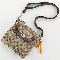 Coach Parker Signature Swingpack Shoulder Crossbody Bag Khaki Mahogany F49148 Photo